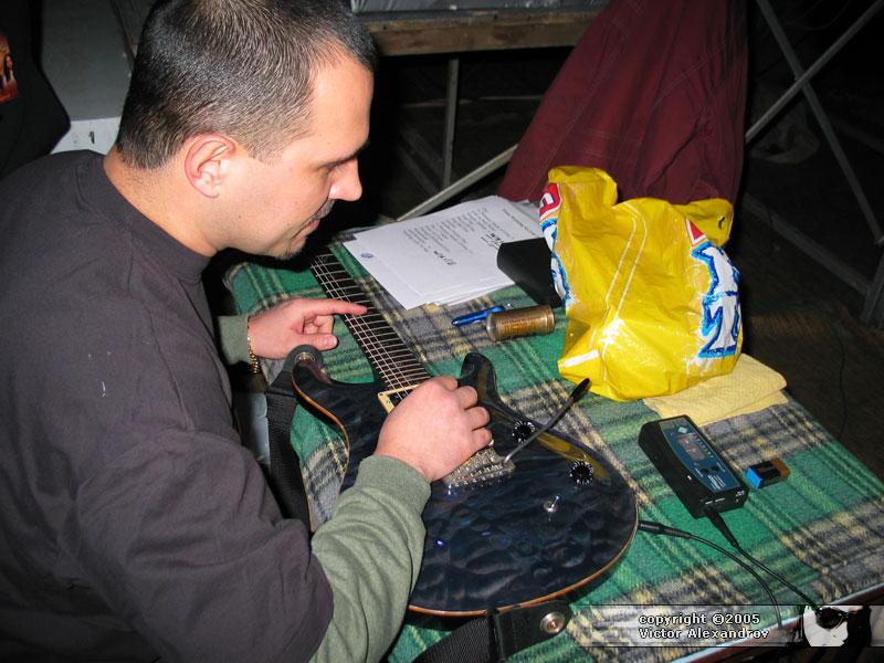 Guitar tech hard at work